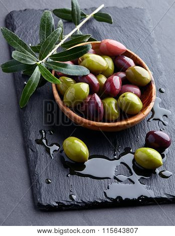 Olives with leaves on a black background
