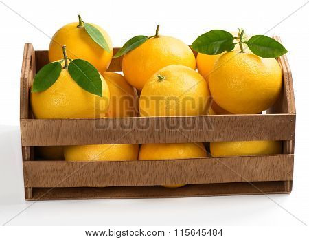 Fresh And Ripe Grapefruits In A Wooden Crate