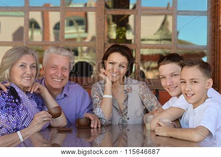Happy family with coffee