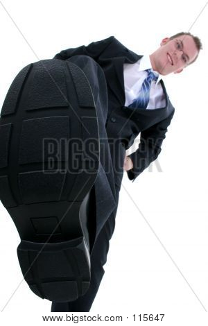 Businessman Stomping Out The Competition