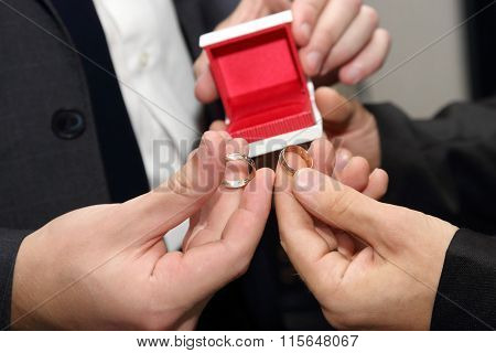 The Groom And His Witness Carrying A Wedding Ring Closeup