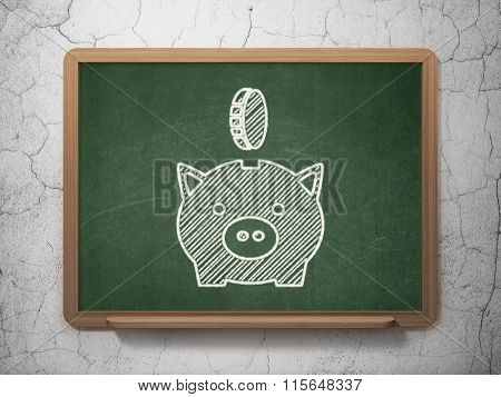 Money concept: Money Box With Coin on chalkboard background