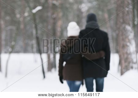 Happy couple in arms of walks in nature. Love story. Photo in defocusing