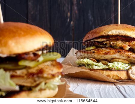 Burger with chicken, cheese sauce and mushrooms