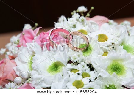 Wedding Rings On Bride's Bouquet
