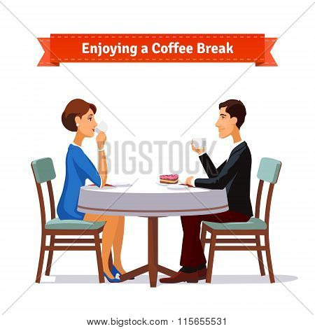 Man and woman enjoying a coffee break an some cake