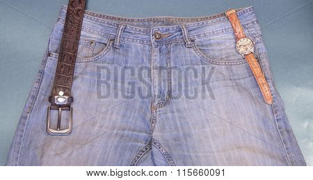 Youth Jeans, Wrist Watches, Leather Strap On A Blue Background