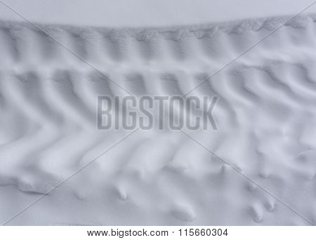 Tire Tracks On Snow.