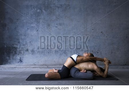 Couple practicing yoga together, passive stretch like thai massage