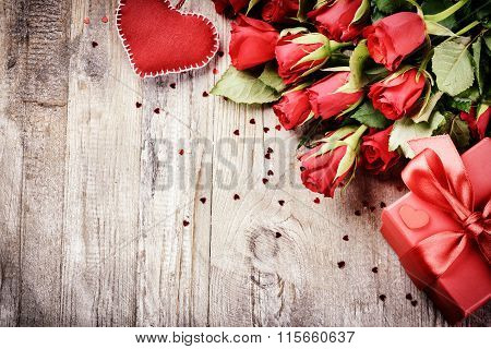 Bouquet Of Red Roses With Decorative Heart And Present. St Valentine's Concept