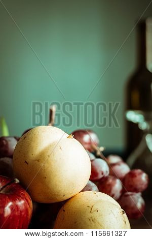 Pears and other fruits on the table. ** Note: Visible grain at 100%, best at smaller sizes