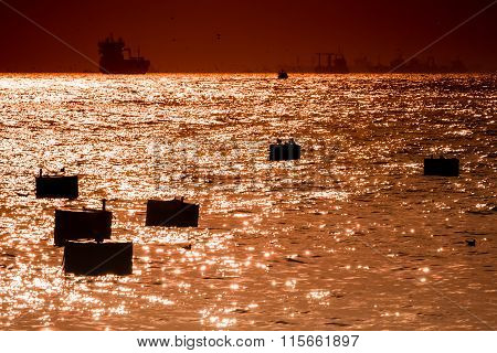 Mooring Buoys And Ships Silhouette At Sunset In Bosphorus, Istanbul
