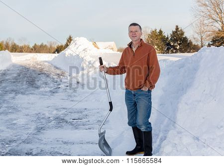 Senior Adult Man Happy After Digging Out Drive In Snow