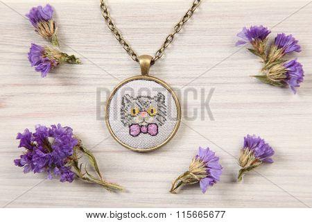 Handmade cross stitch pendant