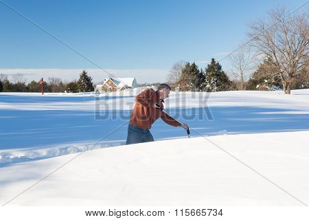 Senior Adult Man Trying To Dig Out Drive In Snow