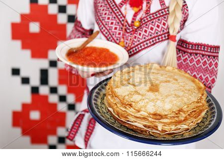 pancakes and red caviar in hands