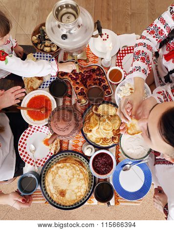 Table with pancakes. Shrovetide top view