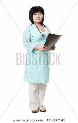 Asian brunette nurse with stethoscope around neck and the x-ray picture of human skull in her hands,