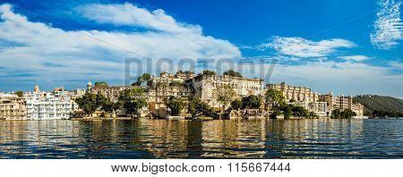India luxury tourism concept background - panorama of Udaipur City Palace from Lake Pichola. Udaipur, India