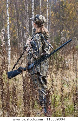 Woman Hunter In Camouflage