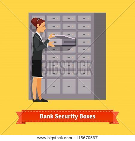 Bank clerk woman opening safe-deposit box