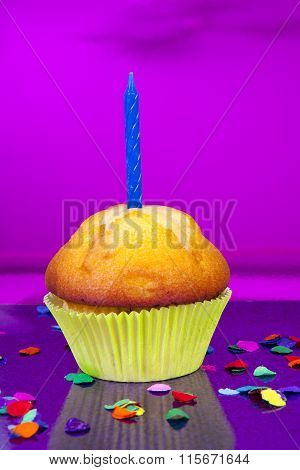 Birthday Cupcake With Candle And Colorful Confetti