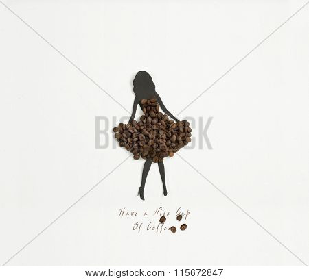woman silhouette wearing a dress of coffee beans