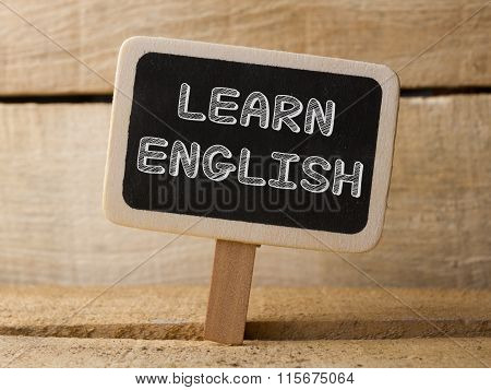Chalkboard on wooden background with Learning English words