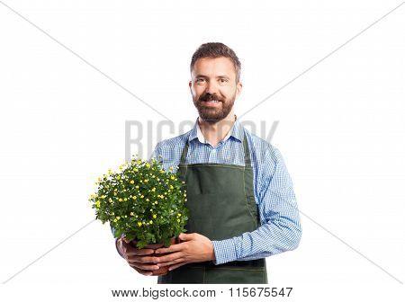 Young handsome gardener