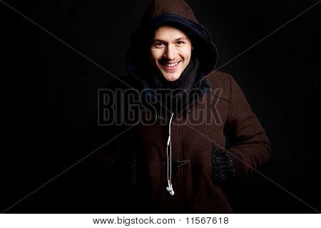 Fashion Male Portrait With A Hodded Coat