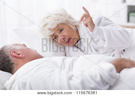 Senior Marriage Discussing In Bed
