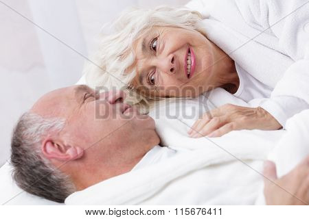 Amorous Senior Couple In Bed