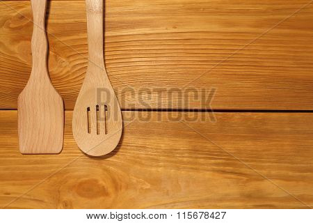 The Composition Of Wooden Spoon And Kitchen Spatula Lying  On A Panel Of Vintage Brown Boards With F