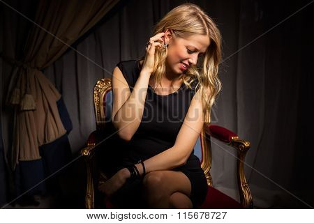 Pretty woman sitting in chair and looking down