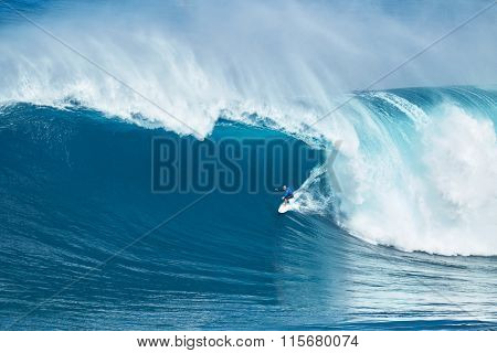 MAUI, HI - JANUARY 16 2016: Professional surfer Shane Dorian rides a giant wave at the legendary big wave surf break known as