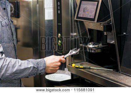 Man going to prerare coffee maker