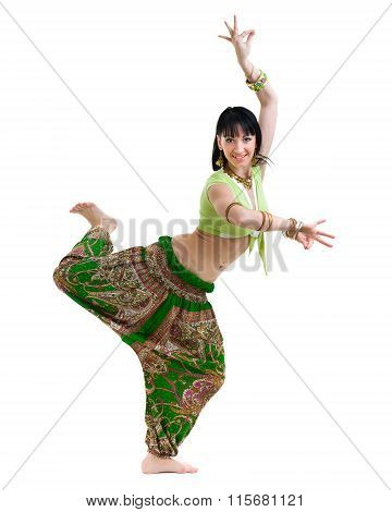 full length portrait of indian woman dancing in studio.  Isolated on white