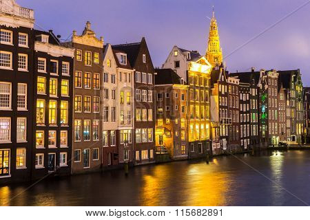 Amsterdam Canals and Saint Nicholas church at dusk Netherlands
