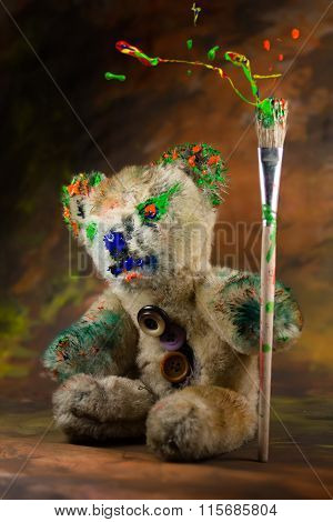 Colorful Paintbrush In Hand Of A Wizard Teddy Bear