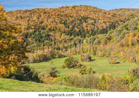 Falls Foliage And Little Hut In Vermont Countryside.