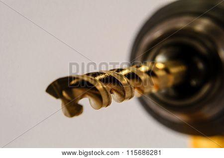 Shiny Gold Drill Bit In Drill