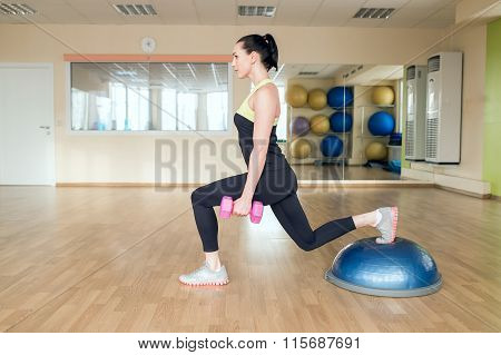 Beautiful Young Woman Doing Fitness In The Gym