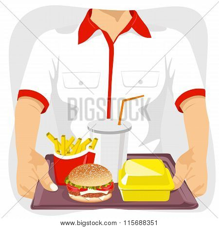 male fast food restaurant employee holding tray with common fast food snacks