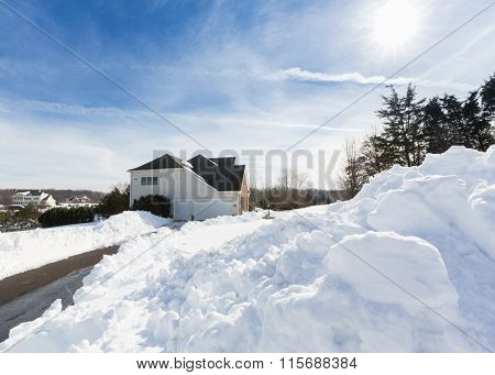 Deep Drifts By Side Of Driveway To Modern Home