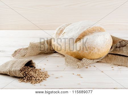 White Bread With Grains And Wheat Spikelets Lying