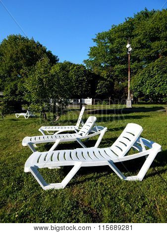 Outdoor furniture on lawn grass near cottage