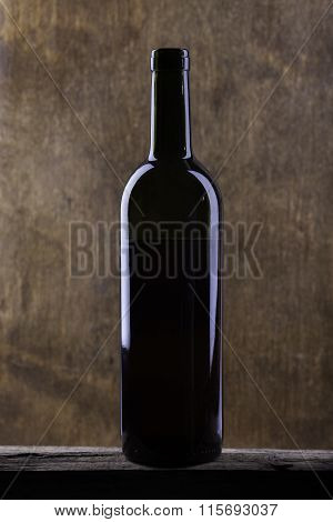 wine bottle on a background of old wood