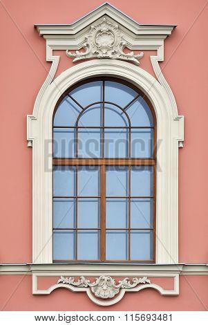 Window on pink wall.