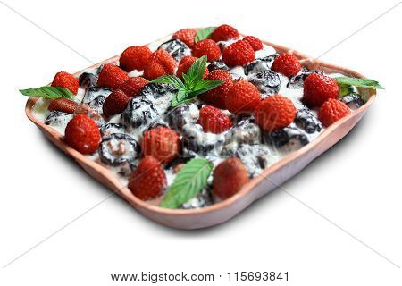 Strawberries Mint Prunes In Cream On Dish Isolated On White