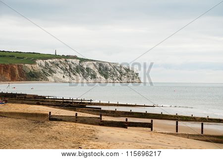 A Beach And White Cliffs On The Isle Of Wight